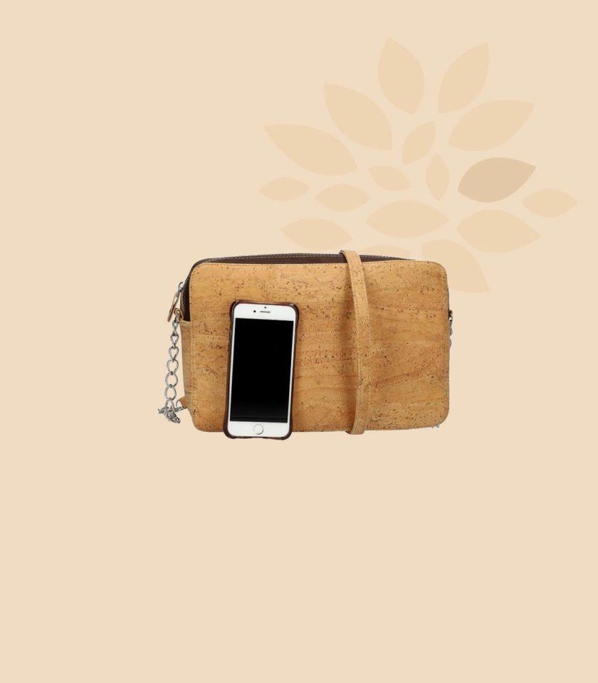 Sac bandouilère en liège Concordia vue de face avec smartphone
