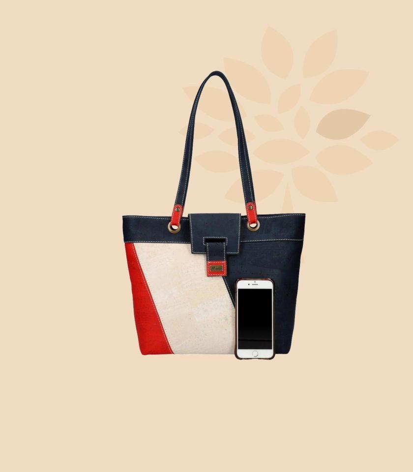 Sac à main en liège modèle Toucan vue de face couleurs rouge crème bleu avec smartphone
